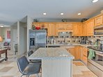 Grab a quick bite to eat at the 2-person bar seating on the kitchen island.
