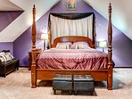 Head up to the master bedroom, which hosts a king bed.