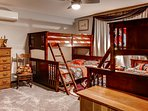 Kids will like the set of twin-over-queen bunk beds in the third bedroom.