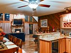 The living room opens up into the fully equipped kitchen.