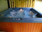 relax with a hot tub massage