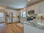 The beautiful kitchen has stainless steel appliances and granite counters!