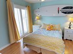 Guest room has a queen size bed, small deck and has direct access to a full bath.