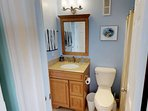 There is a full bath accessible the guest room and main living area.