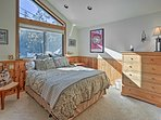 Wake up to natural light in the spacious bedroom.