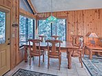 Savor homemade meals at this quaint table set for 5.