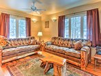 The living area is highlighted by rustic wood furnishings and Northwoods decor.