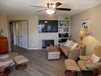 Living Room with 55 Inch Samsung LCD TV and Dish Network Americas top 200
