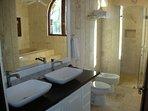 Upstairs master bath -- all bathroom are coralina stone