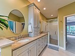 The master bathroom is also equipped with a his-and-hers vanity and walk-in shower.