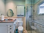 Wash up in the single vanity and walk-in shower featured in the second full bathroom.