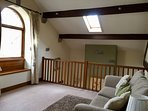 Mezzanine level which overlooks fireplace. Great views over river. Double sofa bed on request