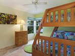 Bright 3rd bedroom with wooden bunkbeds comfortably accommodate 3 children, with views of their own
