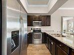 Alerio C304 - Kitchen Featuring Stainless Steel Appliances