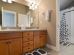 Dual sinks in the upstairs bath are separate from the toilet and shower/bath, offering groups privacy