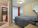 The third bedroom, with en suite bath, has sliding doors leading to a small outdoor space