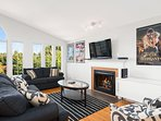 The living area features a queen size sleeper sofa, electric fireplace, and flat screen tv