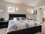The master suite occupies the entire top floor of the home, with a spacious outdoor deck, air conditioning, and TV