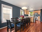 The open concept entertaining area flows from living room to dining area to kitchen
