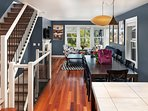 The dining area flows straight through to the living room and kitchen