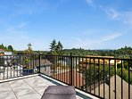 The master suite enjoys phenomenal views from its oversized deck.
