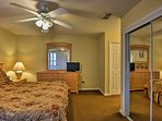 The master bedroom features a flat-screen TV and ample closet space.