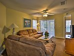 A flat-screen cable TV and 2 plush sofas adorn the living room.