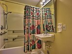 Freshen up in the second bathroom with a shower/tub combo.