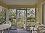 Look out to wooded views from the screened-in lanai.