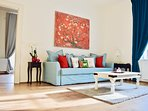 Elegantly decorated, light, airy living room with sofa bed, ideal for relaxing.