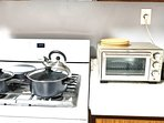 Toaster oven, oven range, tea kettle, and non-stick cookware for all your cooking needs