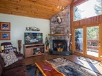 The Living room has it all - seasonal fireplace, wall of windows, mtn views, comfy/cozy cabin decor