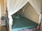 Romantic bedroom (king size) on the first floor. Air conditioning in room.