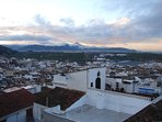 A view from the rooftop terrace. Sunset over the mountains to the west