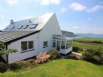 Holiday let on the ground floor of Brae Fasach with views from the conservatory, lounge & kitchen.