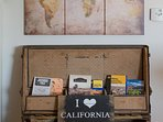 The travel trunk includes hiking guides and books about the areas history, flowers and animals.