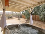 Hot tub has a view of the nearby hills.