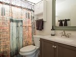 sparkling clean bathroom includes a hair dryer.