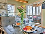 Savor delicious meals from the 2-person kitchen table.
