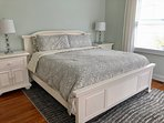 The 1st floor master bedroom has a king bed.