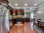 Sleek and Stylish Gourmet Kitchen Fully-Equipped With Stainless Steel Appliances