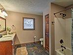 Easily freshen up in the en-suite bathroom!