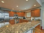 Granite counter tops adorn the fully equipped kitchen.