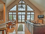 Live lakeside at this Roscommon vacation rental home!