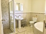 The master bathroom ensuite has a shower and tub