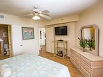 Enjoy TV or the ocean view from the king size bed
