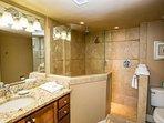 Recently redecorated master bath, walk in tile shower, granite countertops, beautifully updated.