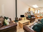 Living area with tv and woodburner