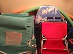 Kids bedroom closet full of chairs, toys, games n umbrellas