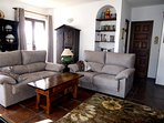 Smart and comfortable, the living room mixes modern furniture with some antiques.